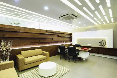 Office design pune based architects anjali ashwin for Modern real estate office design