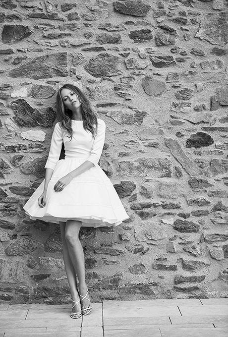 "Brides.com: . ""Alexis"" long sleeve wedding dress with full skirt, $1,966, Delphine Manivet"