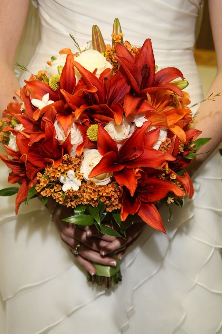 Burnt Orange Wedding Bouquets | Bride's fall bouquet, burnt orange lilies and ivory ... | Autumn Wedd ...