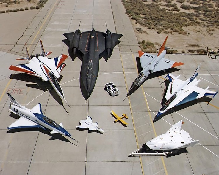 From left to right off the top of my head  T-91, F-15, SR-71, Mirage, F-16 concept?, NASA concept?