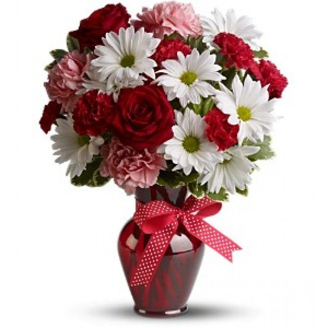 The charming bouquet includes white daisy spray chrysanthemums, pink carnations, red miniature carnations and red roses accented with fresh greenery in a stylish red vase.