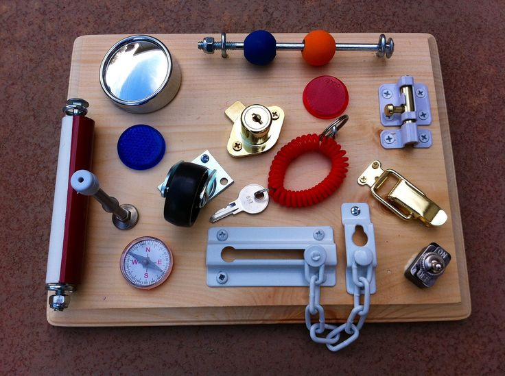 Lock-And-Key Busy Board. Etsy shop with handmade busy boards. Holly would love the lock and key