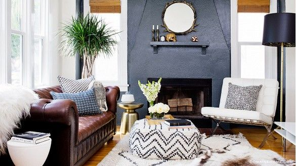 Rumi Neely of Fashion Toast's chic LA bungalow, featuring a brown leather Chesterfield couch, luxe fur throws, and masculine elements