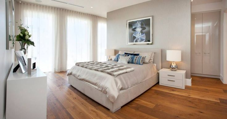 The generous master bedroom features warm timber floors & dressing suite behind the bedhead wall...