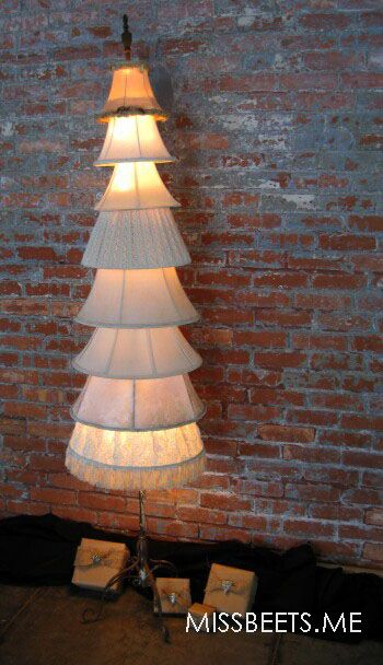 Lamp shade Christmas Tree. Repurposed vintage lamp shades creating an amazing Christmas tree.