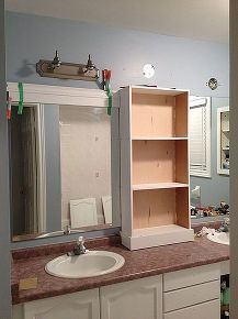 Builder grade mirror upgrades - center cabinet to split up the long mirror