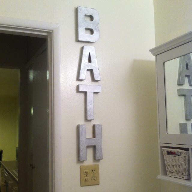 My fake metal letters that I put in the bathroom! Wood letters from Joann's and some metallic spray paint.