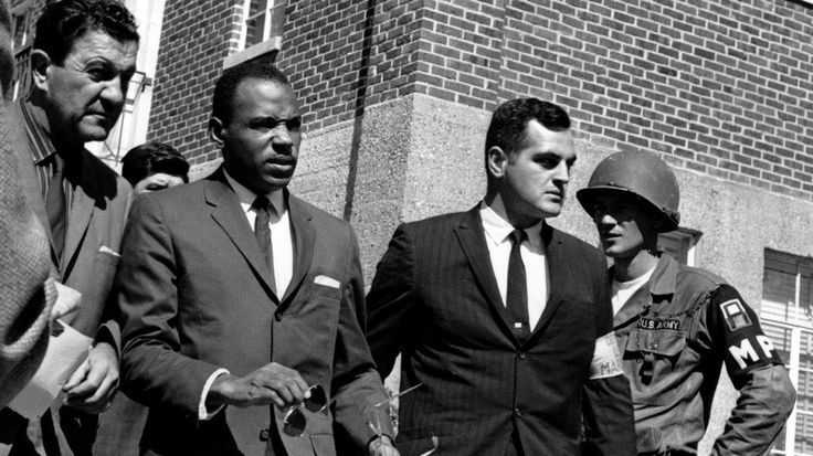 October 1, 1962 - Three thousand troops quell riots, allowing James Meredith to enter the University of Mississippi as the first black student under guard by Federal marshals.