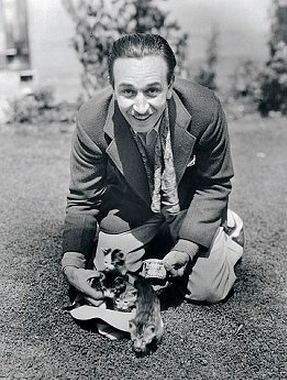 Walt Disney and some kittens. I would like to know the story behind this pic.