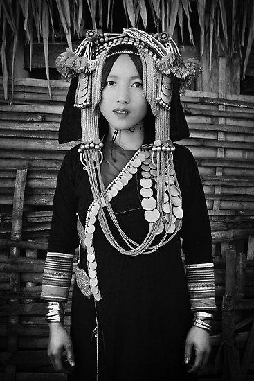 Laos, Phongsali Province, Papuon Mai village, Akha hill tribe, lady with traditional headdress.  | © Glen Allison