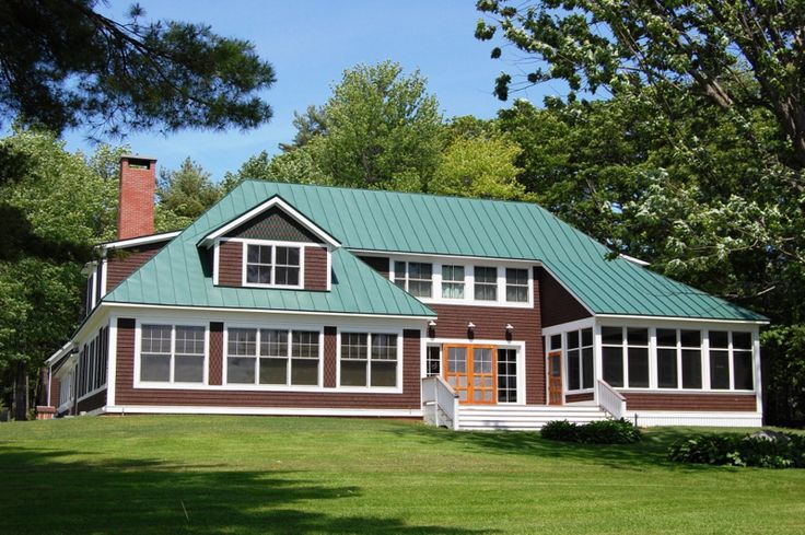 Englert metal roofing plays well on 39 golden pond 39 green - Exterior paint colors with green metal roof ...