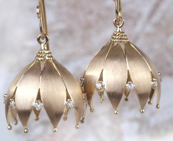 Jasmine Jhumki - A modern take on the south Indian favourite jasmine flowers, this pair of jhumkis is handcrafted in 18k yellow gold with a sprinkle of diamonds.