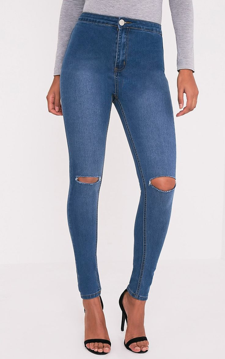 Jean skinny délavage moyen taille haute déchiré aux genouxLe jean skinny déchiré est devenu incon