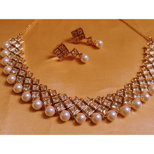 Shop Designer Pearl And Kundan Choker by Runjhun Jewellery online. Largest collection of Latest Necklaces online. ✻ 100% Genuine Products ✻ Easy Returns ✻ Timely Delivery