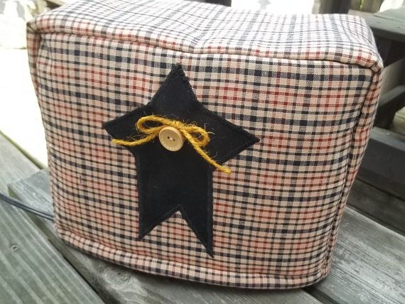 My Primitive Rustic Star toaster covers will add a touch of Americana to your kitchen counter! These are sewn in a black, burgundy and tan plaid homespun with a black cotton star appliqued on the center. A tan button is added with primitive jute. My toaster covers have a quilt lining for thickness and are fully lined inside with solid cotton fabric.  I am also able to sew these without the star if preferred.  ***My 2 slice toaster cover will fit a traditional 11 x 6 1/2 x 8 tall toaster....