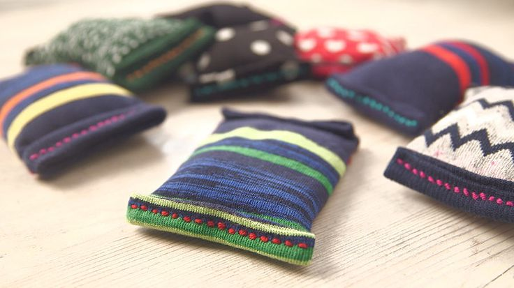 Upcycle odd socks into pocket-sized reusable hand warmers, perfect for chilly days.
