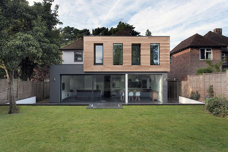 Nice mix of timber cladding and a rendered extension on a traditional brick finish house.
