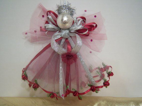 This wispy tulle angel holiday ornament is lavishly and lovingly embellished with ribbons, garlands, floral findings, and craft jewels. Each one is