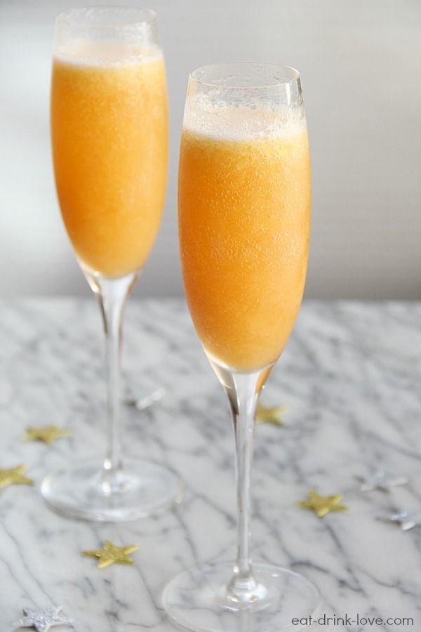 Peach Bellinis - Eat. Drink. Love.  1 cup frozen peaches, 1/4 cup peach schnapps, 1 1/2 tblsp sugar, 1 cup ice cubes, 1 cup champagne or prosecco