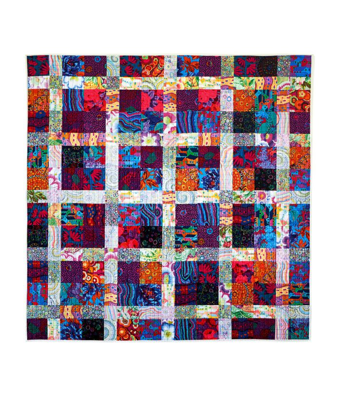 Quilt a Picnic Blanket to Use Up Extra Fabric - Threads.   How about using that huge stash of Egyptian fabrics for this?