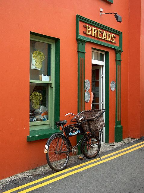 Nostalgic delivery bike in front of a bakery in Kilkee, County Clare, Ireland.  Thanks to Janine Haak for sharing this colourful capture on her page at Flickr: http://www.flickr.com/photos/janinecloudwalker/133132370/in/photostream -- Eve.