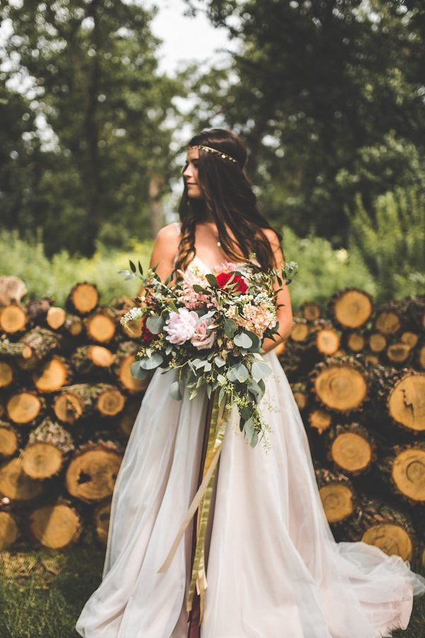 Golden bridal crown, billowing gown, and lush bouquet | Xandra Photography