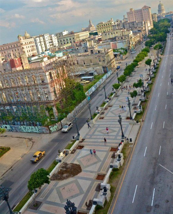 Paseo del Prado, Havana, Cuba. The first paved street in Havana, that divides Centro Habana from Old Havana. In 1772 the are was designed by French landscaper Jean Claude Nicolas Forestier. The street was/is lined with hotels, cinemas, theaters and mansions built in styles from Paris, Madrid and Vienna. After the Revolution, the buildings fell into further deterioration.