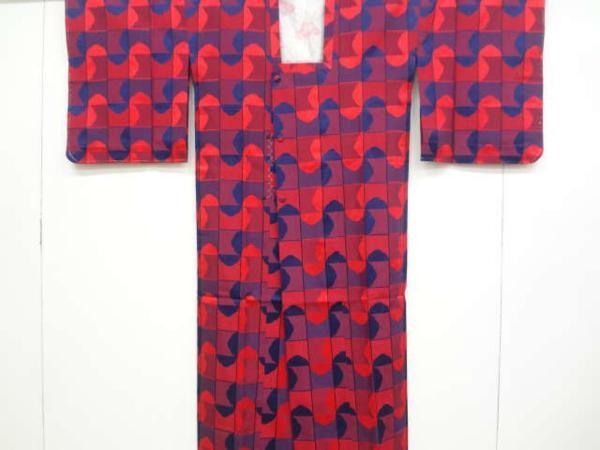 格子に抽象模様織り出し雨コート210