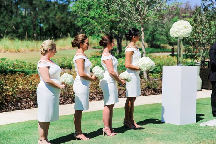 Classic short white bridesmaid dresses paired with udpos - such an elegant look! (Scribbled Moments Photography)