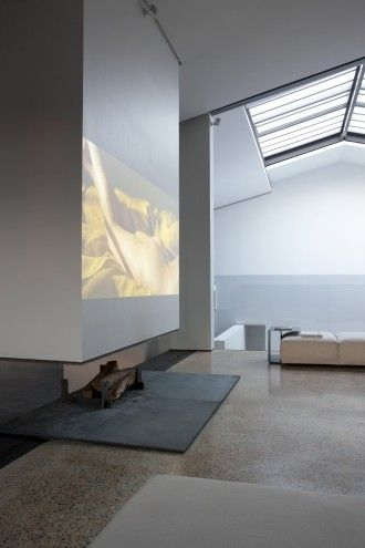 | FIREPLACE | I've always hated exposed TV over a #fireplace, love the combination of low fireplace with projection wall above. Image Credit: Unknown (please let me know so I can include appropriate credit)