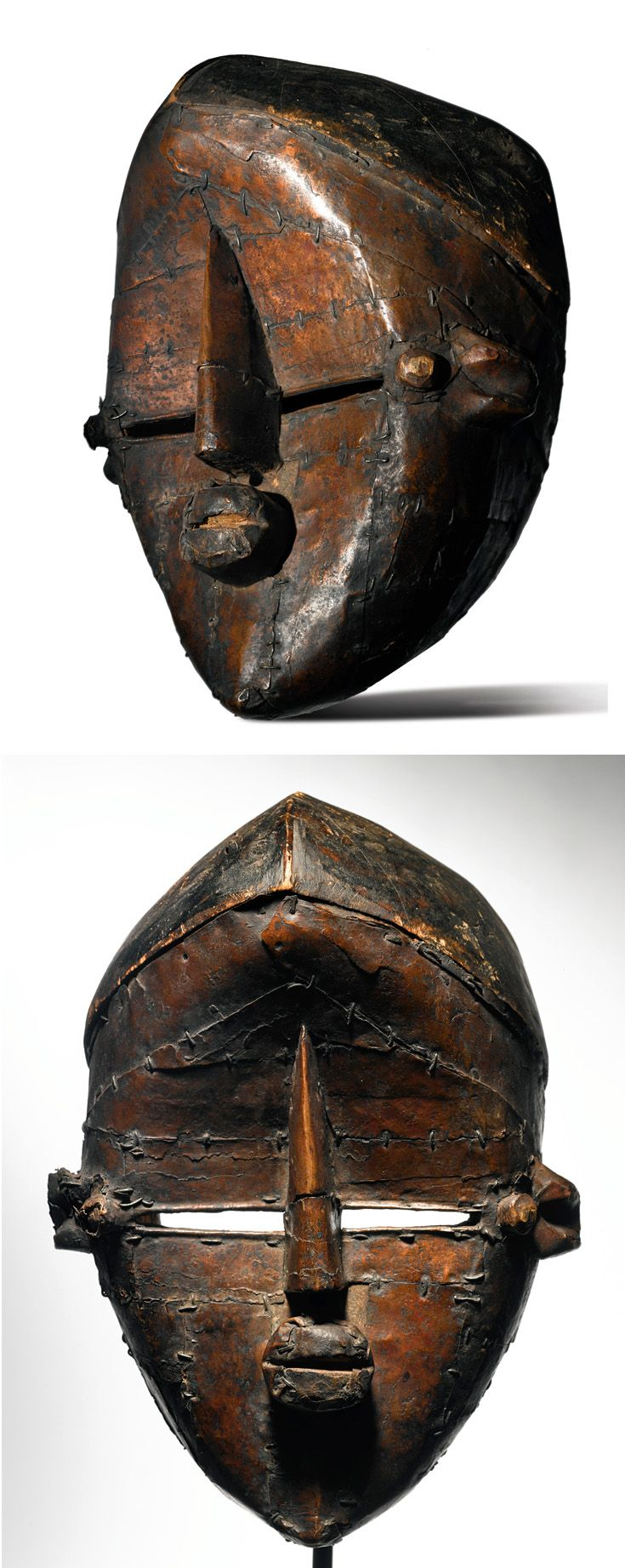 Africa | Mask from the Lwalwa (Lwalu) people of DR Congo | Wood covered in metal (copper sheeting / hammered copper) | 2nd half of the 20th century