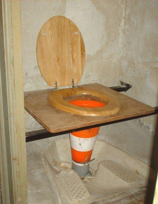 Cool toilet for peeing in the shower. #2 has to go somewhere else. In the 5 gallon bucket with the sawdust?