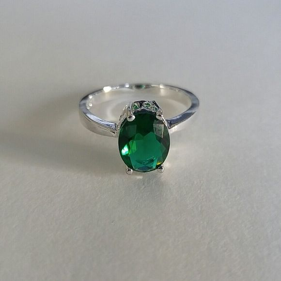 Green Topaz Oval Solitaire Ring Sterling Silver Green Topaz Oval Solitaire Ring. Size 9. Can be sized Jewelry Rings