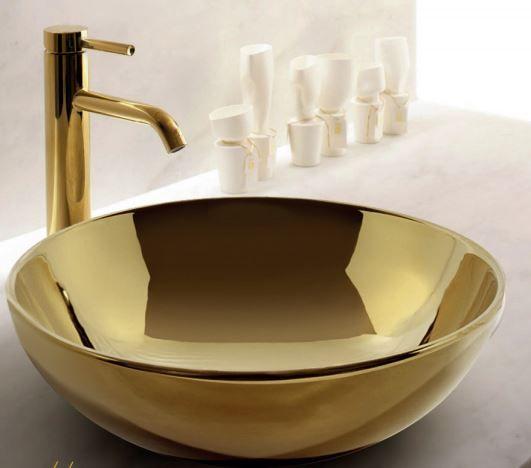 Lavabos elegantes y sofisticados donde el dorado es el for Lavamanos empotrados