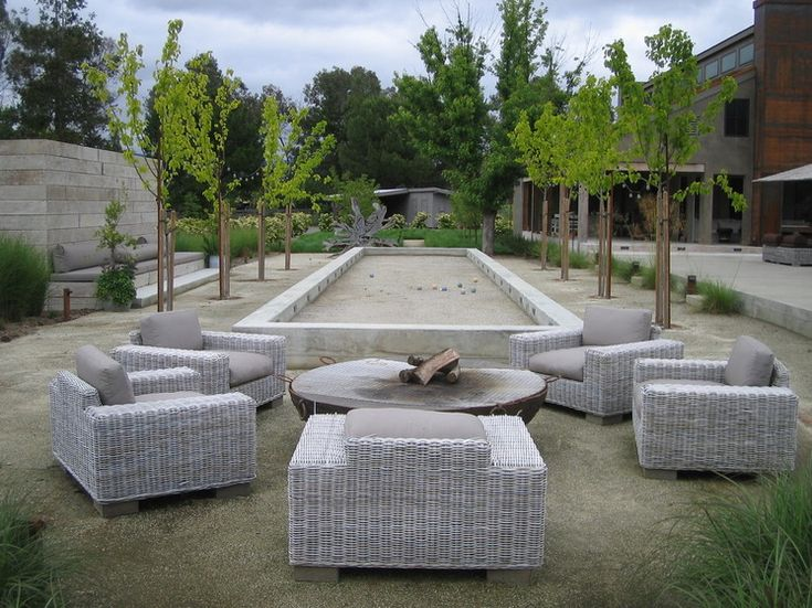What to Know About Adding a Backyard Bocce Ball Court         Farmhouse Landscape by Lou Penning Landscapes Inc.
