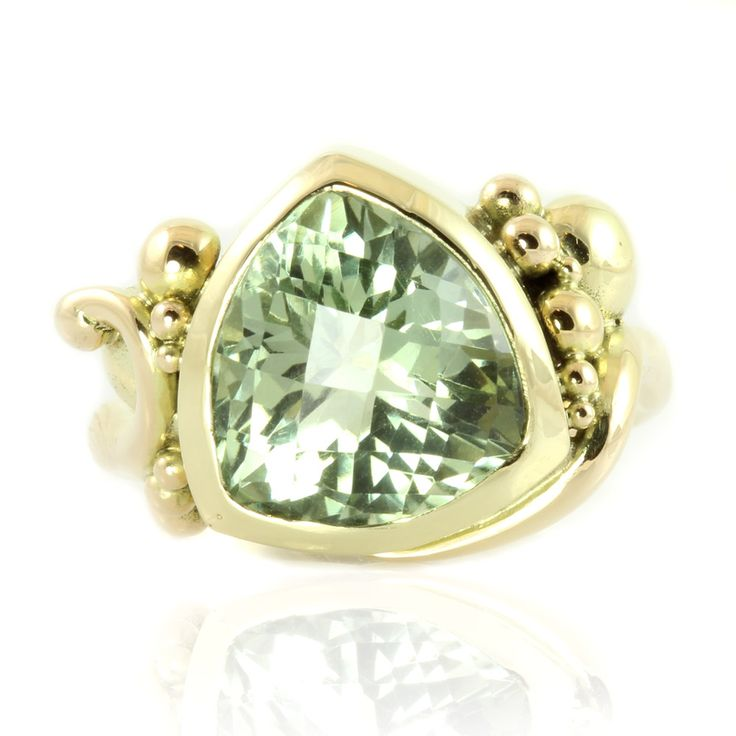Annabell - A mysterious triangular green amethyst / prasiolite is resting amongst jubilant gold bubbles and supported by an elegant curl. This ring is created specifically for this unique gem with fantasy cut.