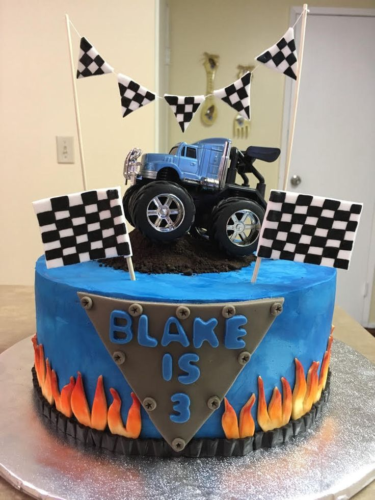 Monster truck cake in buttercream with fondant details and toy truck