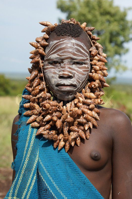 Editorial image of 'JINKA, ETHIOPIA - NOVEMBER 21, 2014: Young Mursi girl with traditional paintings and necklace on November 21, 2014 in Jinka, Ethiopia.'  https://www.colourbox.com/image/mursi-ethiopia-africa-image-24055877