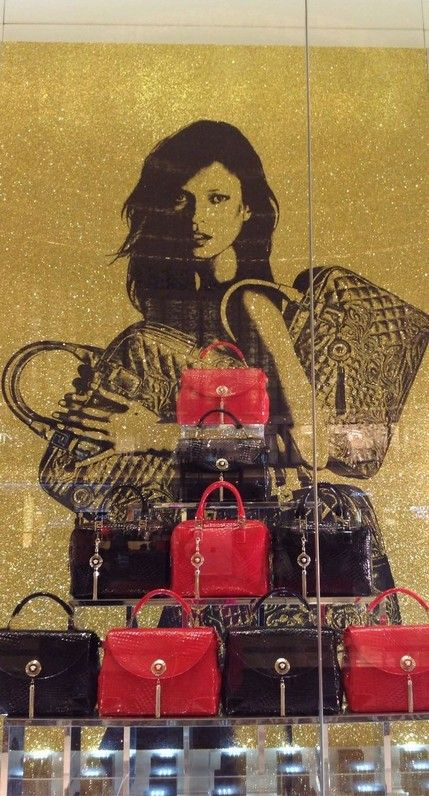 Kate Moss in Versace shop window in Dubai Mall!