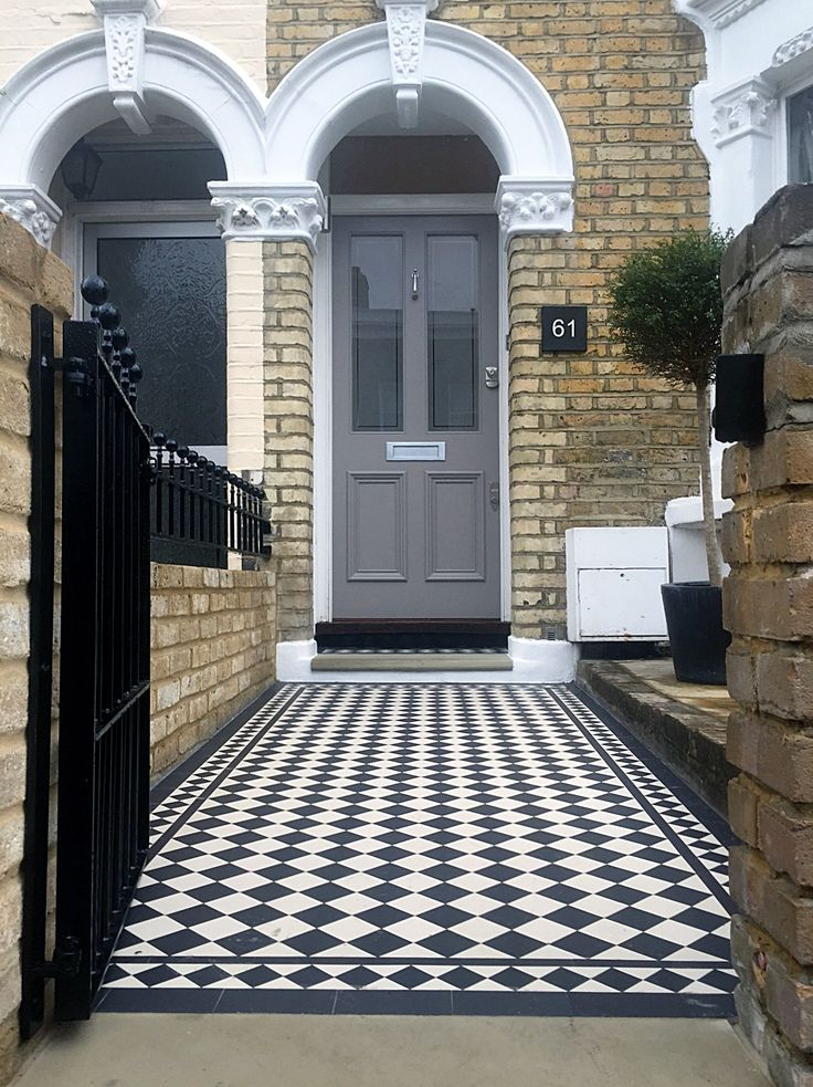 london front door with victorian black and white mosaic tile path and new brick garden wall