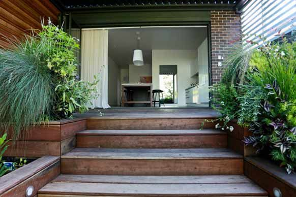 We have a LARGE alfresco dining area, that will have merbau decking - I would love to make the main steps more of a feature leading down to a large lawn expanse - josh & jenna planted some kitchen herbs here to use alongside their outdoor kitchen (ours will just be a standard bbq!)