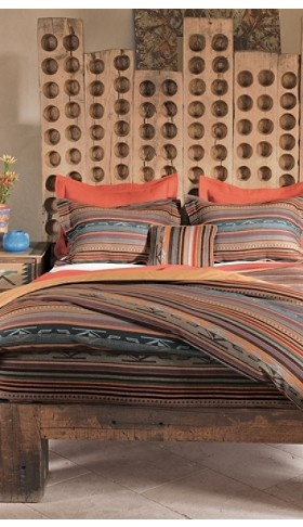 I love that red/orange color. Pendelton- Great idea for a guest bedroom.
