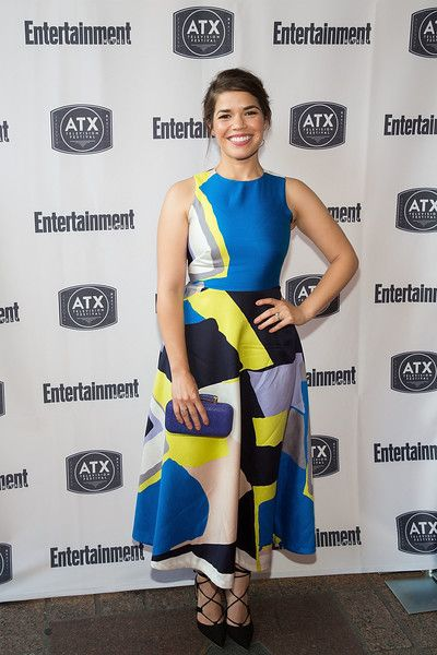 America Ferrera Pumps - America Ferrera's black lace-up pumps and colorful frock were a fab pairing!