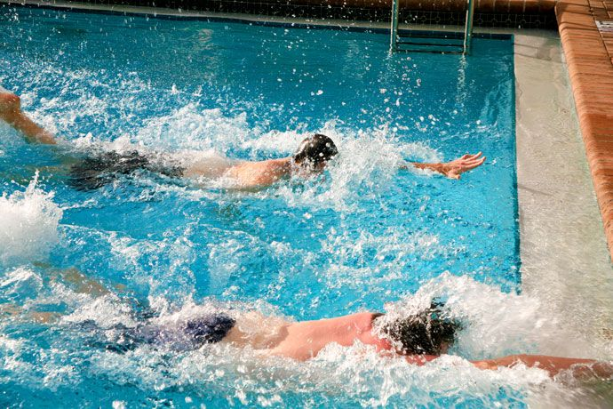 Learn how to swim faster with less effort. Discusses six principles that will allow you to decrease drag and improve the propulsive power of your swim strokes.