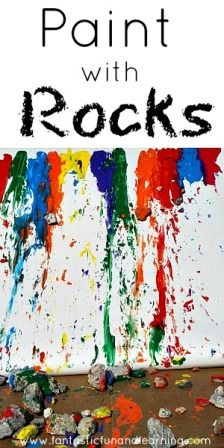 Painting with rocks by sliding them down a large sheet of propped up paper - combining art with physics!