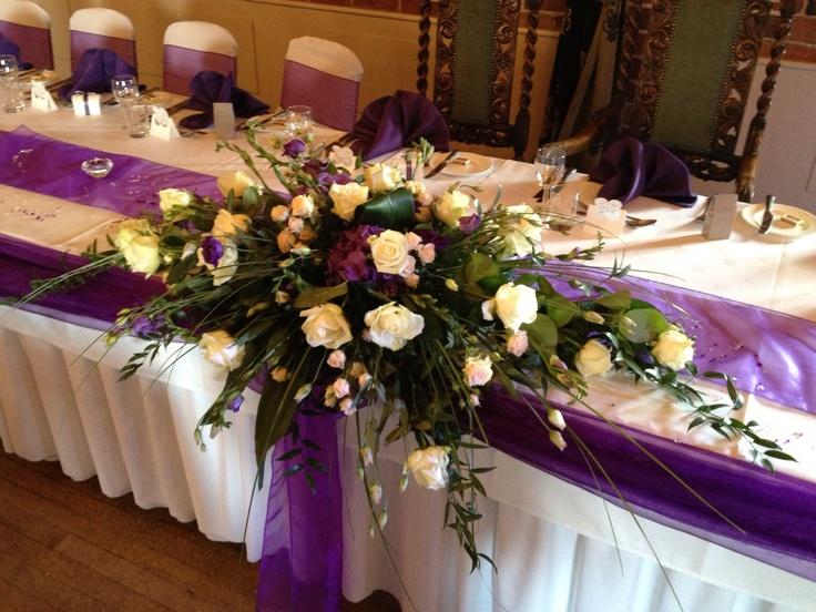 Top Table Arrangement, Avalanche Roses, Jana Spray Roses, Purple Lisianthus, Freesia Hydrangea and Phlox