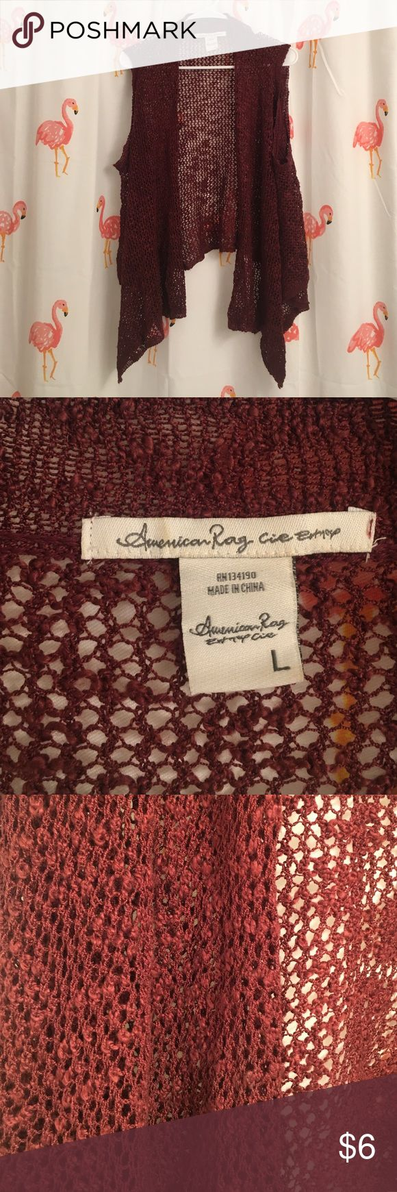 American rag knit vest This burgundy is a lovely fall color. Perfect for the bohemian look. Wide knit with wide arm holes. American Rag Tops