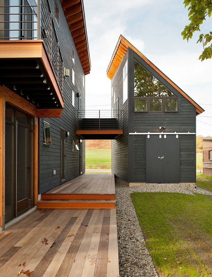 this house is perfect modern black but warm with the natural wood and the guest