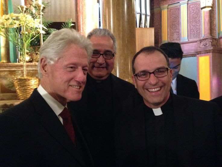 Paulist Fr. Eric Andrews with Bill Clinton for a memorial service honoring Mandela.