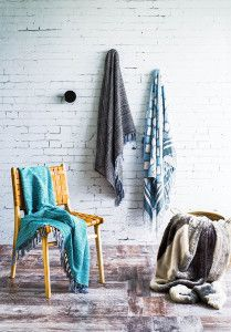 """Crumbling Bricks"" wallpaper styled lovely with soft blue fabrics."